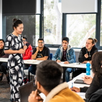 Deakin College classroom with teacher presenting to students