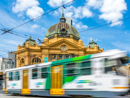 A tram going by Flinders Street Station in Melbourne
