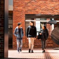 Students walking through Deakin University campus