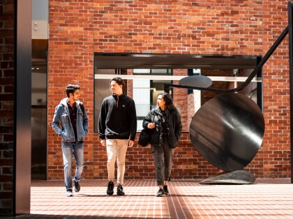 Students walking through Deakin University campus